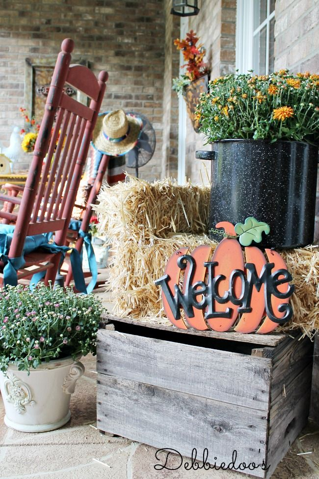 Fall vignette on porch mums, vintage crate and welcome sign from hobbylobby