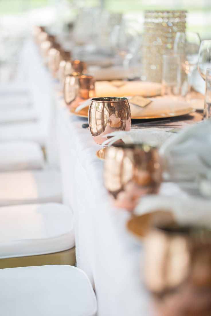 Copper Moscow Mule cups make fun accents for the head table and bonus as a unique favor for your bridal party. Photo: Laura Willis Photography