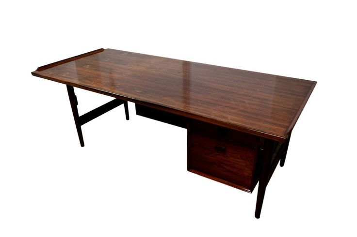 A Danish mid century rosewood desk by Arne Vodder, produced by Sibast