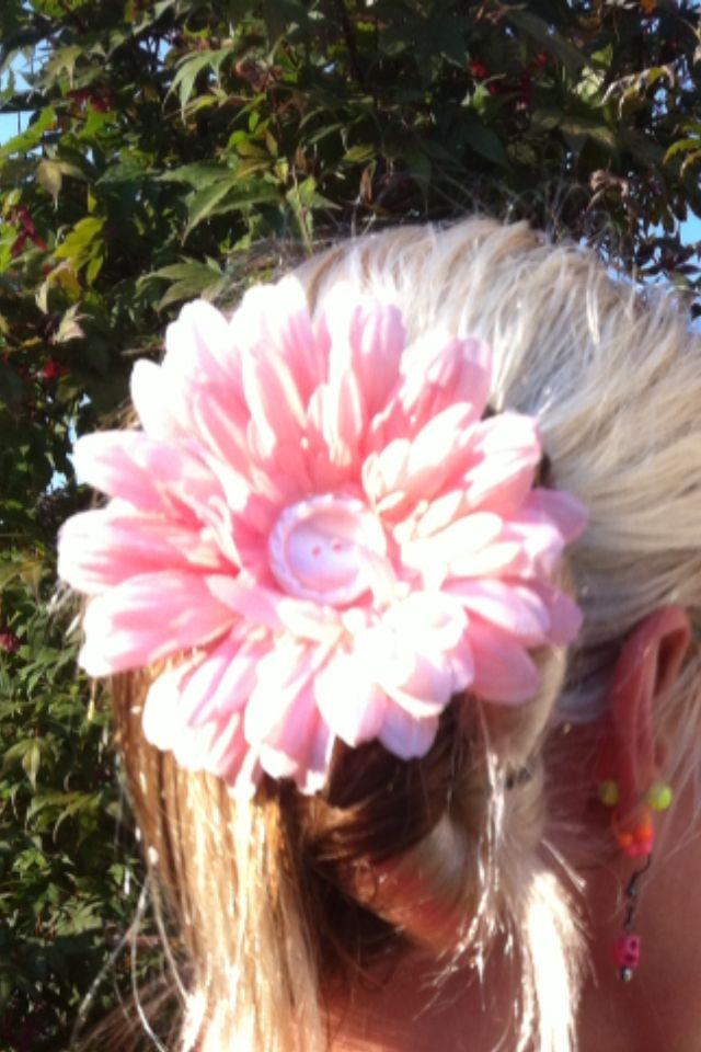 One of my favorite hair flowers. Pretty pink peach color, iridescent pixie dust glitter and a vintage button. $$ I have many of these in my eBay & etsy stores. They start at $9 for the simple ones.  Evilpixiedesigns is my store. If you don't see a color that you want email me at evilpixiedesigns@ yahoo.com
