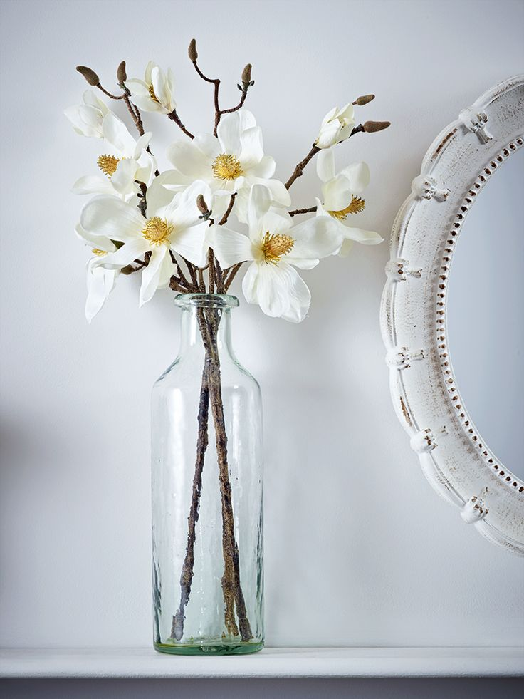Displayed in our Tall Recycled Glass Vase, our set of three magnolia flower stems look so realistic you'll find it hard to believe they're not. These silk-like faux stems can be cut to fit any vase and instantly add a beautiful botanical feel to your home without the hassle of buying new flowers.