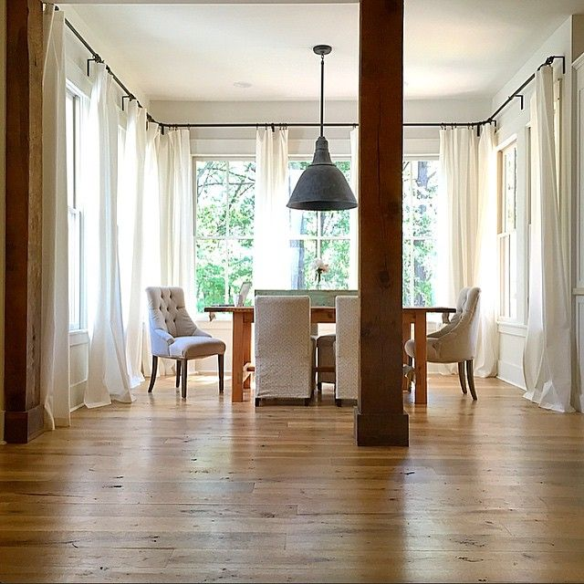 """farmhouseforfour the beams that hold up the second story are """"10"""" x 10""""x 10' heart pine beams that came out of a nearby mill that was being torn down. They're 100 years old! curtain rods hardware is from ikea, custom curtains"""