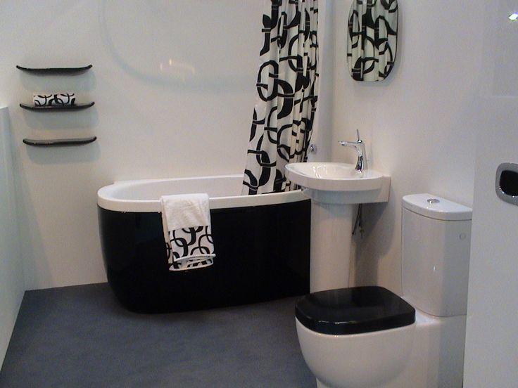 """LAUFEN: """"MIMO"""" IL BAGNO COMPATTO, RICCO DI PERSONALITA'  Mimo di LAUFEN gioca con morbide rotondità e luccicanti superfici in rosa, bianco e nero. E' perfetto per ogni stanza da bagno, con il suo design sofisticato. Con Mimo LAUFEN miscela le sue ceramiche con una gamma di rubinetti realizzati dal produttore svizzero SimilorGroup appositamente per questa linea. Per maggiori informazioni contattaci all'indirizzo info@corapweb.com   #Laufen #Mimo #ceramica #bagno #design"""