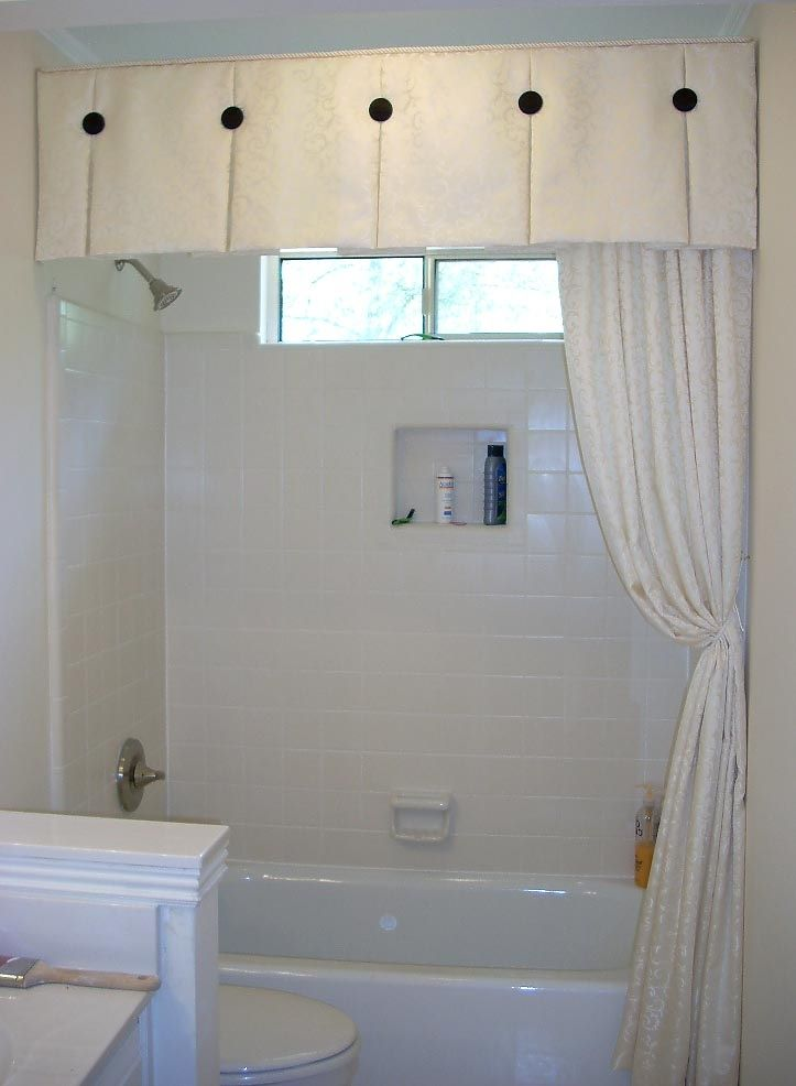 Box pleat valance with black accent buttons. is a great treatment for a shower/tub