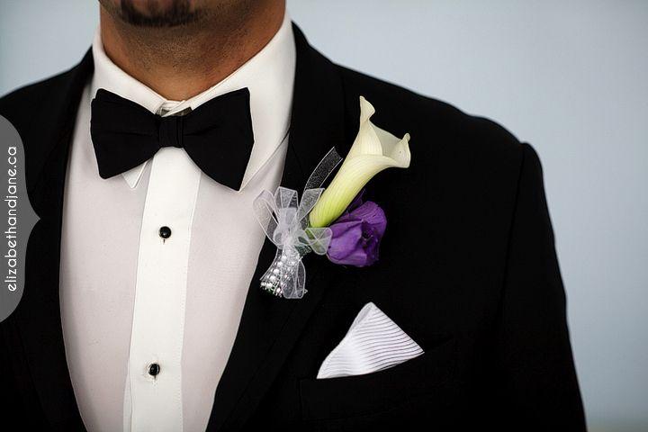 Beautiful white calla lily boutonniere with purple accent.  #ottawawedding #ottawaweddingdecorator #ottawadecor #ottawaflowers #bouquets #613 #weddingdecor #weddingbellesdecor #elegantwedding #weddingideas #weddinginspiration #boutonniere #calla #groomsmen #groomflowers #brookstreet