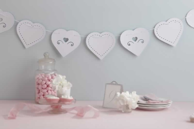 A 3.5 meter string of romantic heart card bunting that has two alternating heart shaped pendants, one plain and one with a dye cut heart and swirl design. Ready to use, this heart bunting adds a charming touch to any venue.