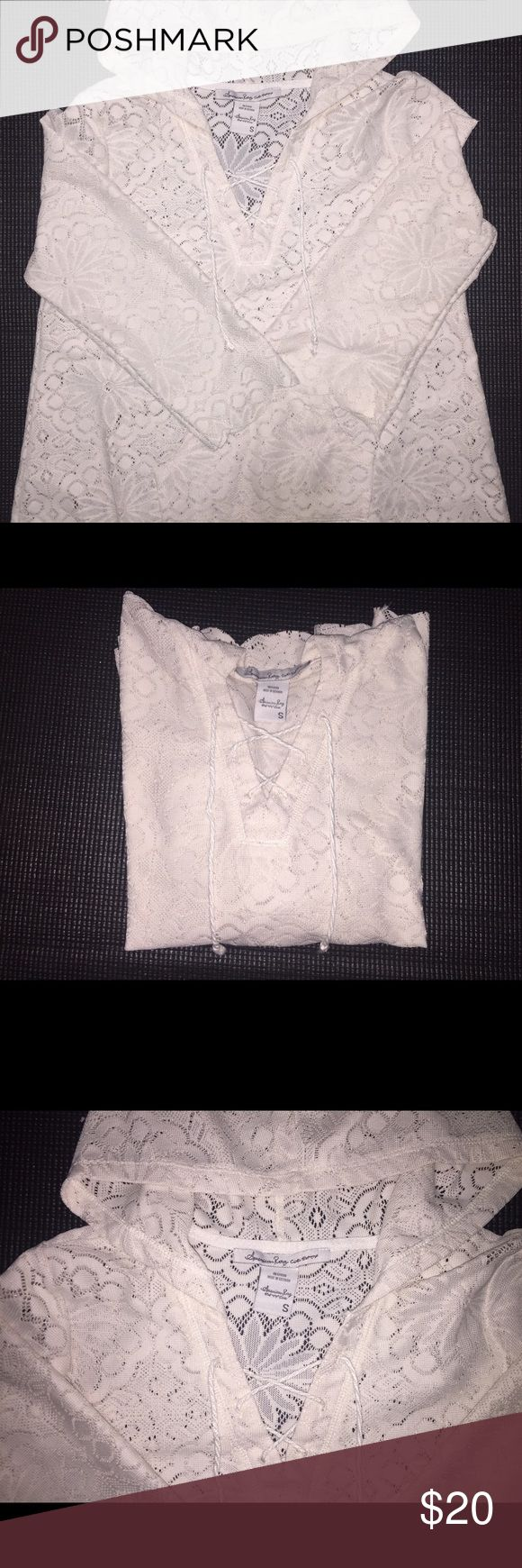 American Rag Lace hoodie Great condition! Worn maybe twice ever. Very cute to later with bralettes! They flare at the end and it's not right fitting which looks great on every body type. I just never wore it as often as I thought. American Rag Sweaters