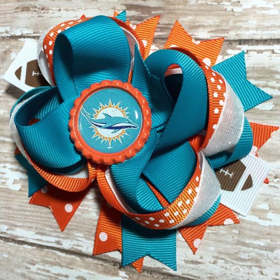 Miami Dolphins NFL Football Hair Bow, 2015 Logo, Infants, Toddlers, Big Girls and Teens, Baby headband, Sports bows https://www.etsy.com/listing/248300423/miami-dolphins-nfl-football-hair-bow?ref=shop_home_active_4