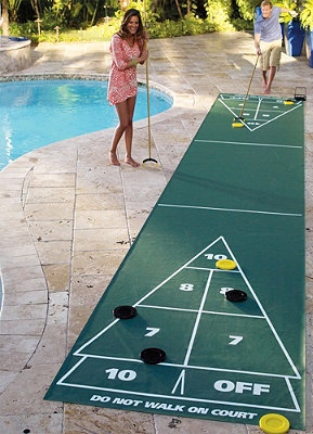 Shuffle board is a great summer time outdoor activity! When the game's over, just roll up the court and put it away.