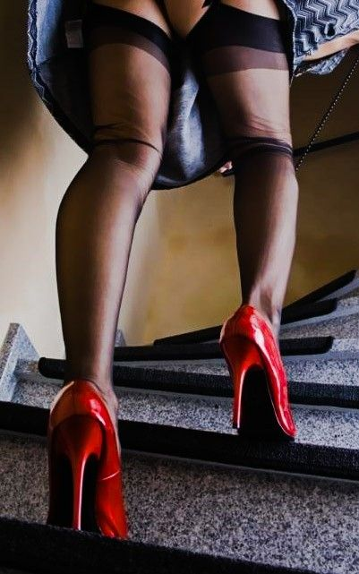 Stairs Upskirt To Show Black Stockings And Glossy Red