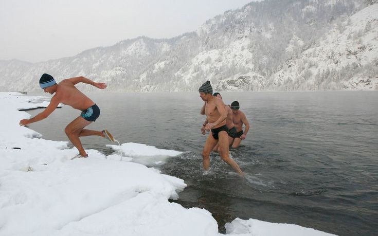 Members of a local winter swimming club take part in their weekly bathing session in the Yenisei River, with the air temperature at minus 17 degrees Celsius, in the town of Divnogorsk, outside Russia's Siberian city of Krasnoyarsk // pic: Ilya Naymushin