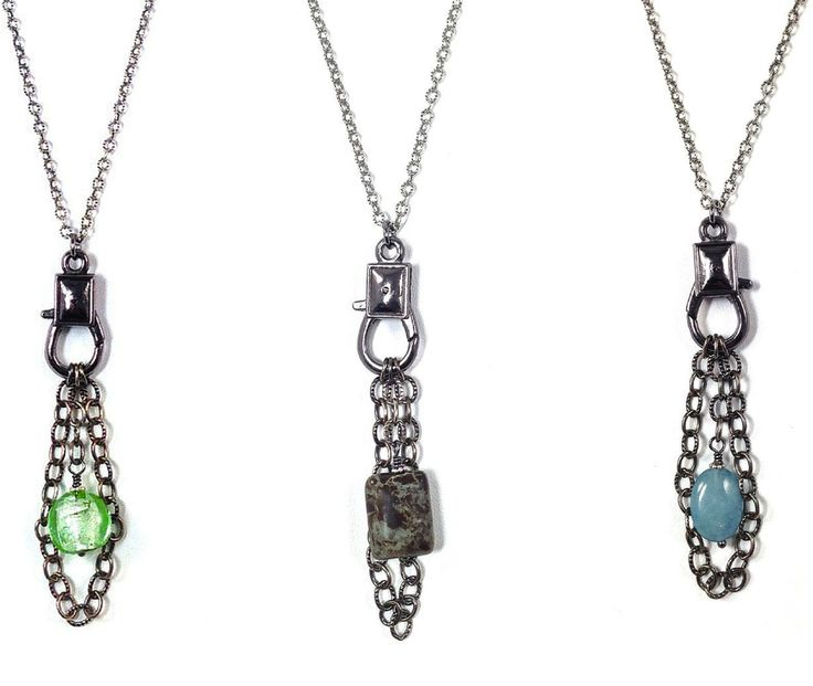 Perfect with a tee and jeans and anything else. Long oxidized sterling silver necklace with an oversized pewter clasp, chain and a pop of color in gemstone or glass.