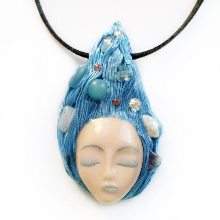 A goddess with sky blue hair adorned with natural semi-precious stones such as: chalcedony amethyst howlit transparent quartz and crystals.  #instajewelry #jewelrygram #jewelrydesign #jewelrydesigner #jewelryaddict #customjewelry #fashionjewelry  #artist #artisan #jewelry #etsyjewelry #handmadejewelry #jewelryforsale s #etsyshop #clayjewelry #artisanjewelry #handmade #crystals  #semipreciousstones #semiprecious #golden #pagan #crystaljewelry #crafter #art #artjewelry #goddess #wiccan #blue…