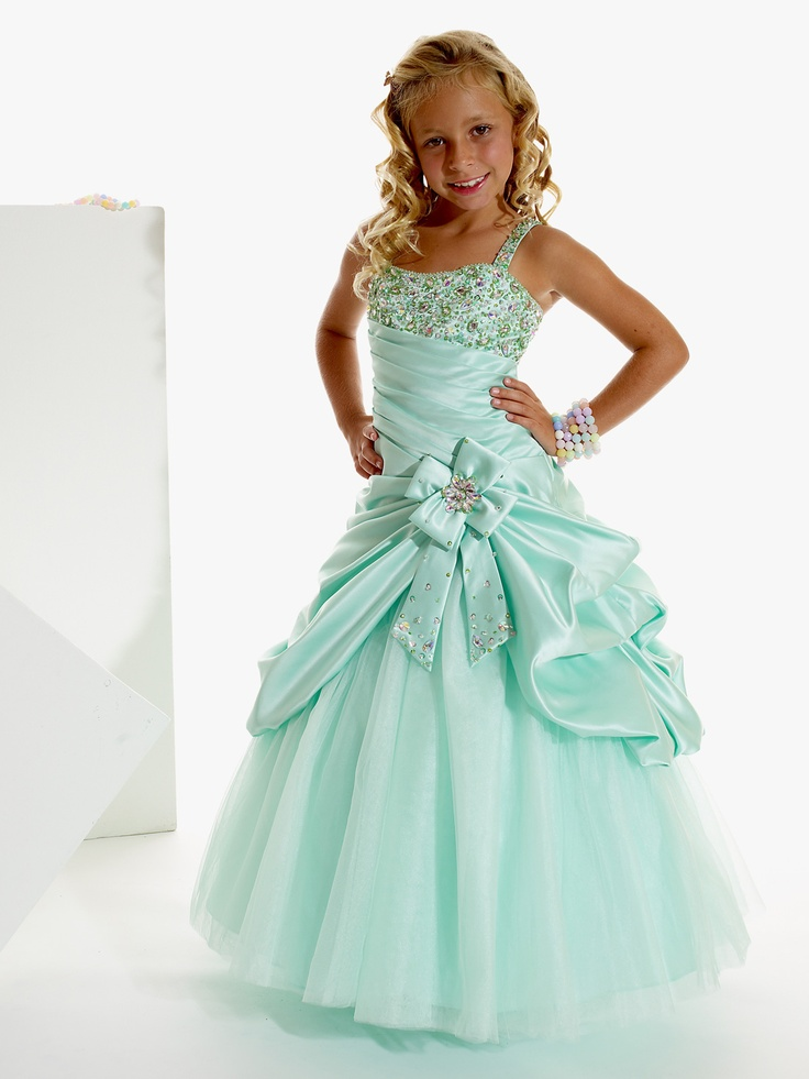 This satin and tulle pageant dress Tiffany Princess by House of Wu Pageant Dress 13263 has a tank bodice with a beaded bodice and pleated midriff. This dress features a draped ball gown skirt with a bow accent. Your girl will look like a princess in this amazing dress.