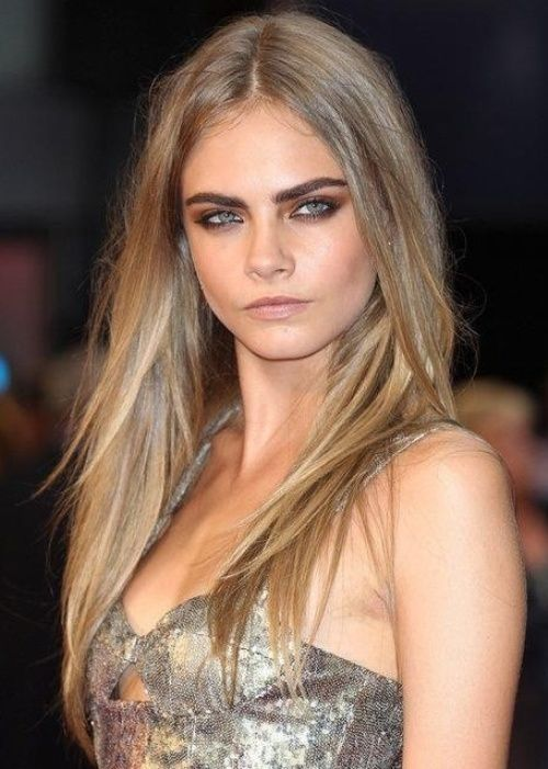 cara delevingne {dirty blond hair color} Fashion model Cara Delevingne rocks straight and sexy dirty blonde locks with bold brows. Cara's dirty blonde hair color is achieved with a dark blonde base and ash blonde overtones that give her hair an ethereal glow. Keep your roots dark and your tips light in a soft ombre fade for extra impact.