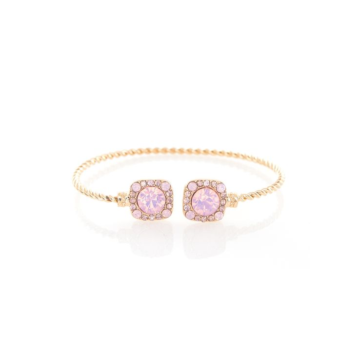 Designed to layer on a bare wrist, the Cristina cuff sparkles with rose water opal colored crystals set on a gold plated base. Embellished in a clustered manner, this bracelet is an evening must-have.