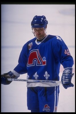 "There is no jersey quite like the powder blue of the Quebec Nordiques which the club so proudly wore from the time they entered the NHL in 1979 until the time they left for Colorado in 1995. The unique color, the artistically shaped ""n"" with a stick and puck at the end of it and of course the fleur-de-lis, made it clear that the jersey represented Quebec City."