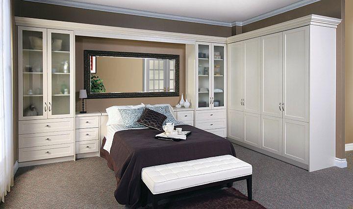 Bed surround with wardrobe.