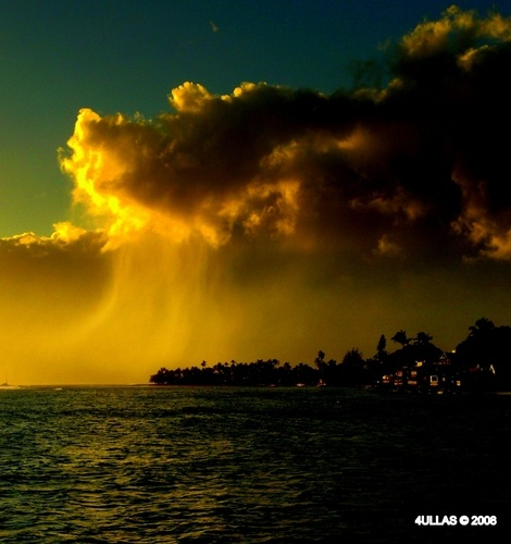 Rainy clouds by the Northern coast of Maui Island at sunset
