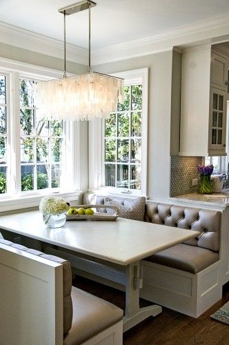 kitchen booth -- love the leather banquettes + light + windows + colors
