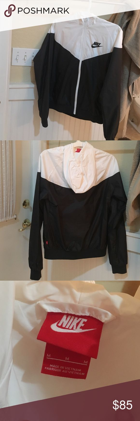 Nike Windrunner Black and white Nike windrunner worn only once. In brand new condition. Never find myself reaching for it. Size M but fits like Sm Nike Jackets & Coats