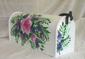 roses and ferns on a hand painted mailbox.