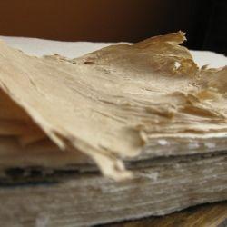 Hand beaten gampi fibers were beaten with a long stick to soften the fibers to make a rustic sheet.