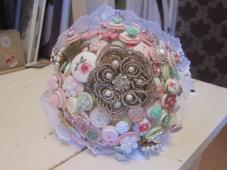 A beautiful vintage bouquet which includes handmade fabric buttons (Cath Kidston fabric) and the most beautiful pearl brooch.