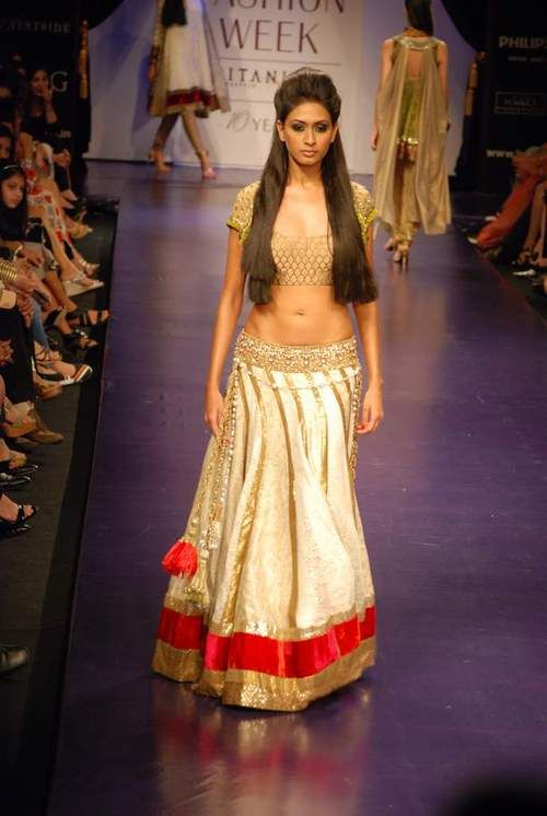 gold lehenga with hints of red