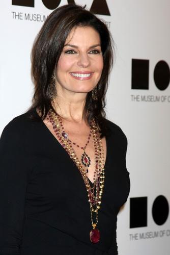 black dress + layered necklaces (Sela Ward).