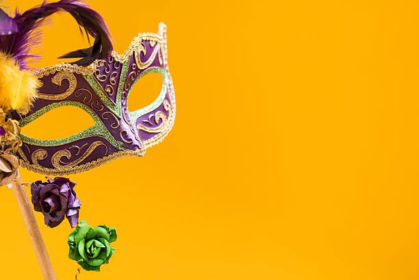 Mardi Gras Mask on yellow Background stock photo