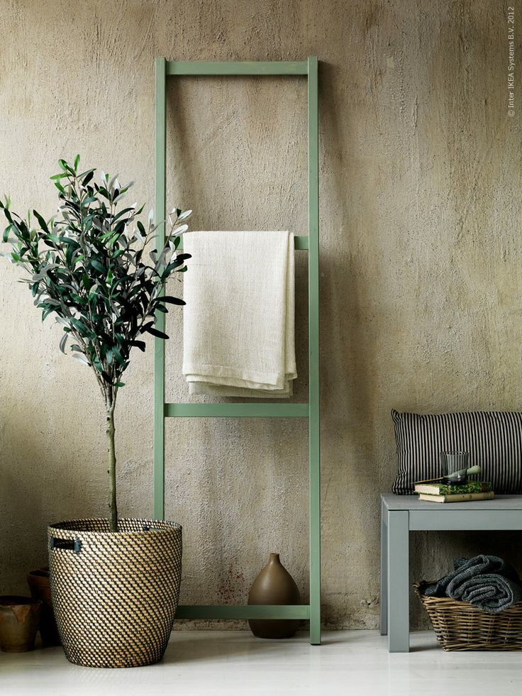 I love round vases, and muted earth tones, and little trees.