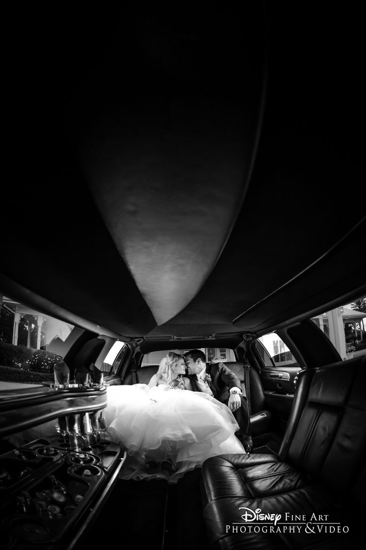 Make a grand exit and head to your happily ever after in a luxurious limousine. Photo: Daniel at Disney Fine Art Photography