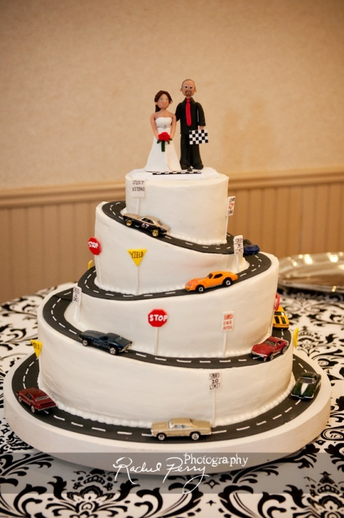 My wedding cake! I am a huge car buff, and on our first date, my husband brought me HotWheels cars, and continued to buy them as we dated. Those are the cars on the cake, with a personalized topper I had made on Etsy. And it was carrot cake with cream cheese icing :)