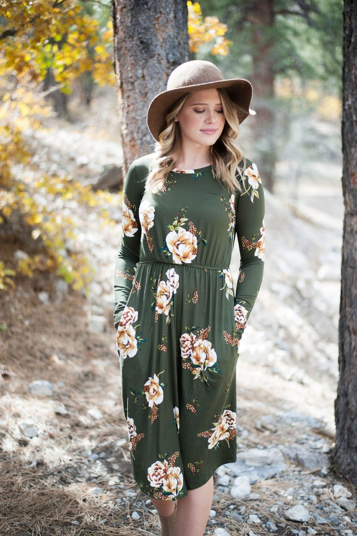 This floral print midi dress in olive is one of our favorites this season! Pairs nicely with your favorite booties or heels. - Full-length sleeve - Cinched waistline - Hidden pockets - Made in the USA