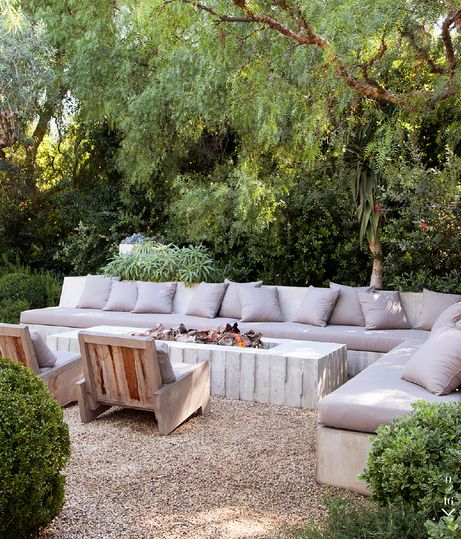 Want to build seating off the retaining wall then add a long oblong firepit. Think it would work?