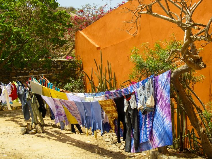 The clothes are drying along a side street on Ile de Goree near Dakar Senegal West Africa.
