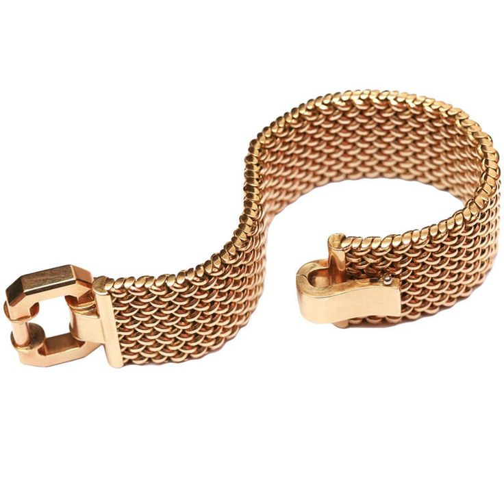 """1940s Italian Gold Bracelet. Of stylised design, composed of overlapping """"knitted"""" links, embellished by a large buckle of geometrical shape evoking the futuristic movement of the time. 1940s, Italian """"Fascio"""" marks. Approximately 97 grams of 18kt yellow gold. Circa 1940"""