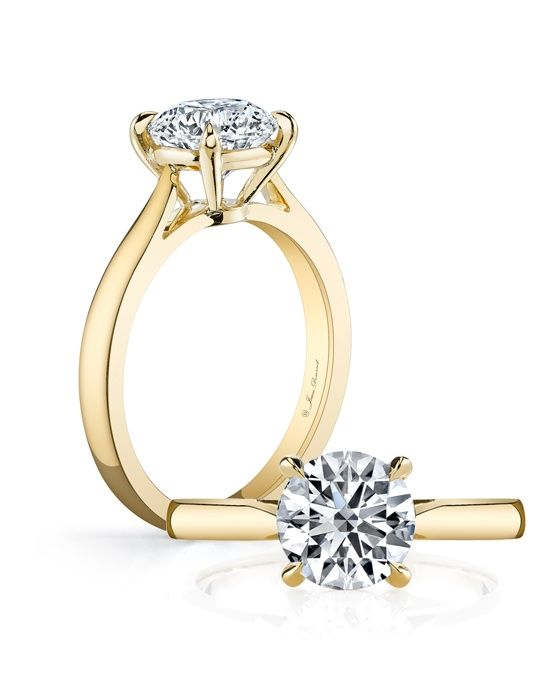 I'm SO happy that yellow gold is coming back in style for engagement rings! I love how the modern, yet traditional this Jean Dousset round engagement ring is