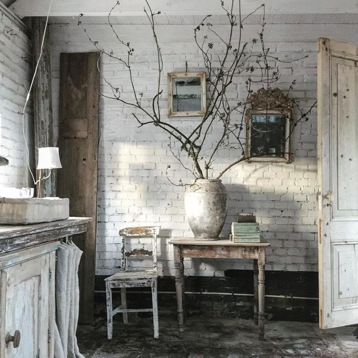 buy faux brick, cover wall, paint and distress.