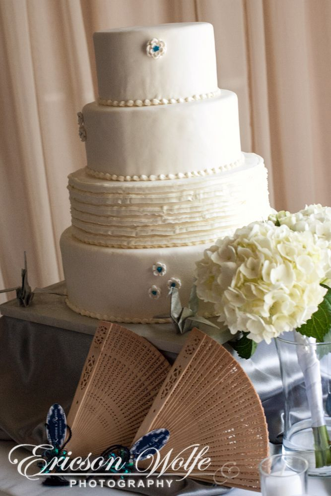 Wedding Cakes Worcester Ma Wedding Cake Cream Colored With Tiny Blue Flower Accents Wedding