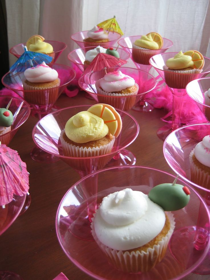 """Cocktail cupcakes : Martini, orange, olive, umbrella. The cupcakes were baked, decorated and placed in a martini glass. These """"cake drinks"""" were served at a Bachelorette Party!"""