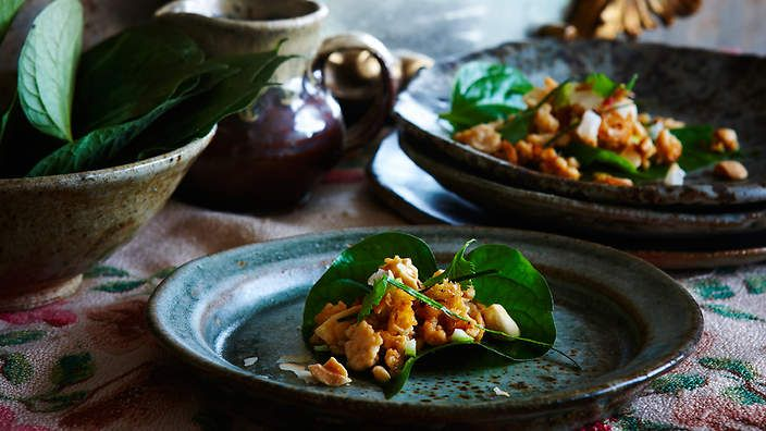 Betel leaves topped with chicken, roasted coconut, peanuts and lime from the food dept. (recipe by Sally Courtney, photography by Petrina Tinslay, styling by David Morgan and art direction by Anne Marie Cummins).