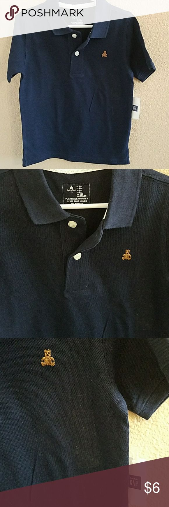 Gap NWT Navy Blue Boys  Polo Size 4 Classic Gap Navy Blue Polo Shirt size 4 NWT Please Note the 3rd Pic is showing some residue from the size sticker GAP Shirts & Tops Polos