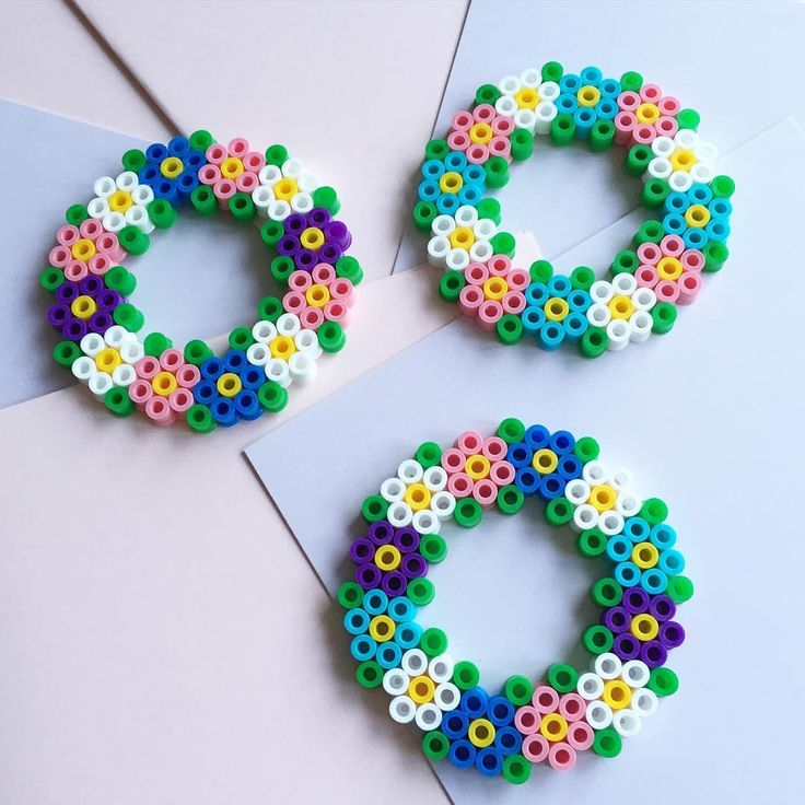 Flower wreaths hama beads by kolossaltpyssligt - Pattern: https://de.pinterest.com/pin/374291419014133811/