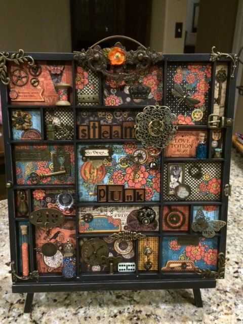 Altered printers tray with Graphic 45 Steampunk Spells.: