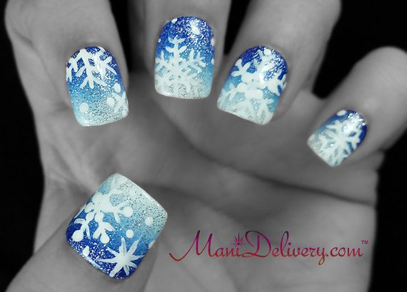 Snowflakes on glittery blue/white ombre hand painted false nails with gel base and top coats