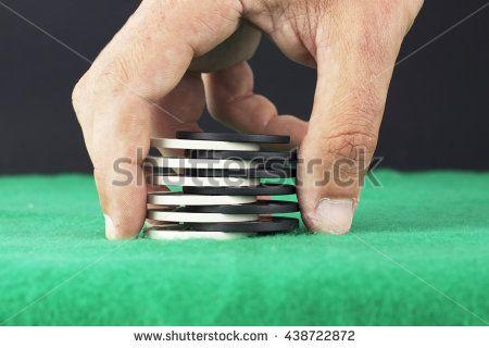 Hand arranging poker chips