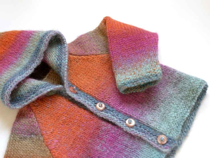 Hand knitted baby cardigan. Unisex boy / girl multicolor: pink, purple, fuchsia, violet, orange, blue, aqua, turquoise. $40.00, via Etsy.