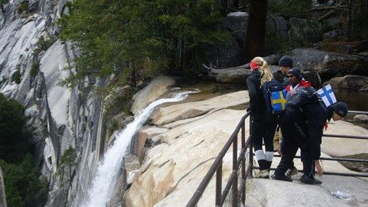 Nordic trekkers by a waterfall in Yosemite National Park, USA #kilroy #np #active #nature #trekking #hiking #backpackers #travel